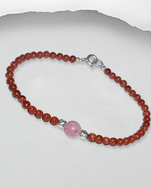 <b>Fine natural quartz, silver and rhodonite bracelet</b>
