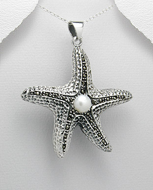 <b>Silver, marcasite and fresh water pearl pendant</b>