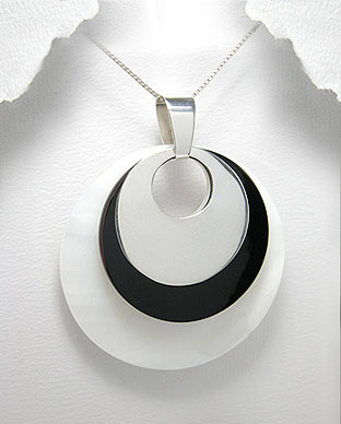 <b>Silver, shell and black resin pendant</b>