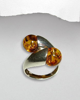 <b>Interesting silver and amber ring</b>
